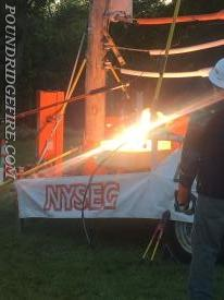 Lineman from NYSEG show how a normal boot will react when contact is made with a live line.